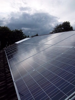 4 kWp Schott 240 Wp polycrystaline and 30 tube solar water heating system in Adel, Leeds