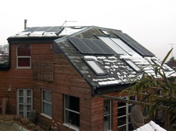 Combined solar PV and solar water heating system on an ecohouse in Brighouse, West Yorkshire