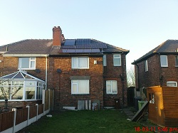 1 x navitron flat panel solar water heating system mounted above the roof, integrated with Sanyo HIP solar PV system