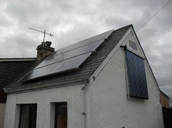 Vertically mounted 20 tube solar water heating system to maximise winter performance and free up roof space for 9 panel Solar PV installation